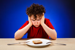 Hungry kid Royalty Free Stock Photos
