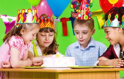 Hungry kids. Looking at birthday cake Royalty Free Stock Photo