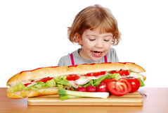 Hungry little girl Royalty Free Stock Photos