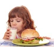 Hungry little girl breakfast Stock Photos