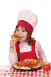 Little girl cook eat pizza Stock Photography