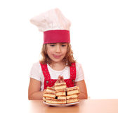 Hungry little girl cook Stock Image