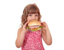 Hungry little girl eat big sandwich Royalty Free Stock Photography