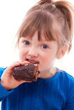 Hungry little girl eating cake Royalty Free Stock Image