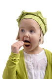 Hungry little girl eating a cookie Royalty Free Stock Image