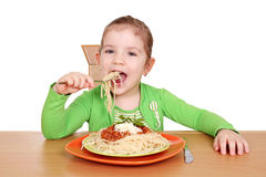 Hungry little girl eating spaghetti Royalty Free Stock Photo