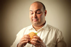 Hungry man Stock Images