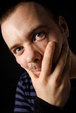 Hungry man. A young man with gray eyes Stock Photo
