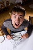 Hungry man. Hungry young man waiting for food in restaurant Royalty Free Stock Photo