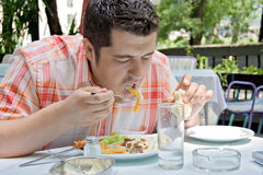 A hungry man. Eating his lunch royalty free stock photo