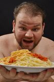 Hungry man. This picture represents a hungry man looking to the pasta Royalty Free Stock Images