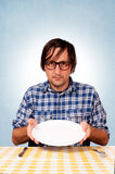 A hungry man. Showing the empty plate Stock Images