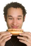 Hungry Man. Holding chocolate donut Royalty Free Stock Image