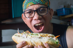 Hungry man baguette sandwich vietnamese style Stock Photo