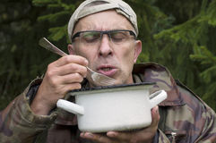 Hungry Man In Camouflage Royalty Free Stock Photo