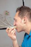 Hungry man eating a wholewheat roll Royalty Free Stock Images