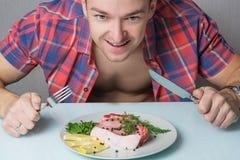 Hungry man eats. Meat Stock Photos