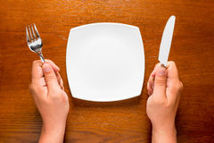 Hungry man with empty plate Royalty Free Stock Images