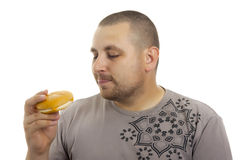 Hungry man with hamburger. Stock Image