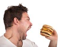 Hungry man Stock Photos