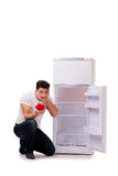 The hungry man looking for money to fill the fridge Royalty Free Stock Images