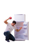 The hungry man looking for money to fill the fridge Stock Photography