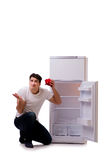 The hungry man looking for money to fill the fridge Royalty Free Stock Photos