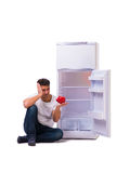The hungry man looking for money to fill the fridge Stock Images