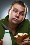 Hungry man with mouth full of bread Royalty Free Stock Photos