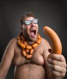 Hungry man with sausages Stock Photos
