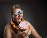 Hungry man with sausages stock images
