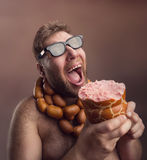 Hungry man with sausages Royalty Free Stock Photography