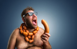 Hungry man with sausages stock photo