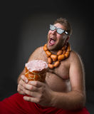 Hungry man with sausages Royalty Free Stock Photo