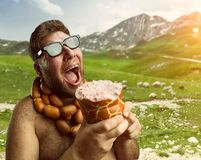Hungry man with sausages Stock Image