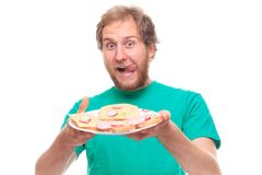 Hungry man with a table of sandwiches Royalty Free Stock Photos