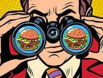 Hungry man wants a Burger. A hungry man wants a Burger pop art retro style. Hunger and food. Man looking through binoculars Royalty Free Stock Photo