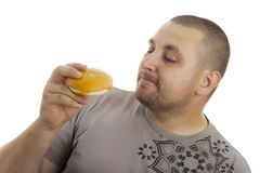 Hungry Man With Hamburger. Royalty Free Stock Images
