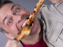Hungry meat-eating man, no diet Stock Images