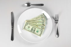 Hungry for Money. With white plate isolated Stock Images