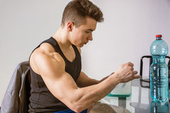 Hungry muscular young man gulping down food Royalty Free Stock Photography