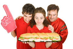 Hungry Partiers with Sandwich Royalty Free Stock Images
