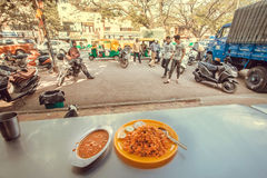 Hungry people going for dinner in street cafe with indian food biryani rice and dal soup Stock Photography