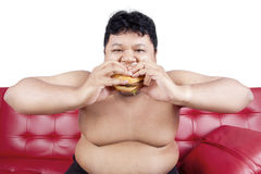 Hungry person eating burger Royalty Free Stock Images