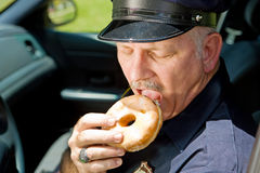 Hungry Police Officer Royalty Free Stock Images