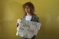 Hungry programmer. Holding a cardboard with text Stock Photos