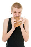 Hungry teenager. Eating bread isolated on white background Stock Photos