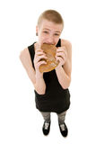 Hungry teenager. The hungry teenager eating a bread isolated on white background Stock Images