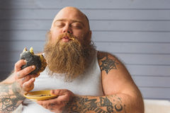 Hungry thick guy chewing junk food Royalty Free Stock Image
