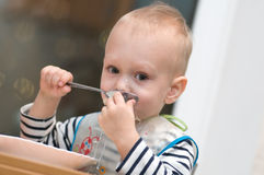 Hungry toddler eating Stock Photos